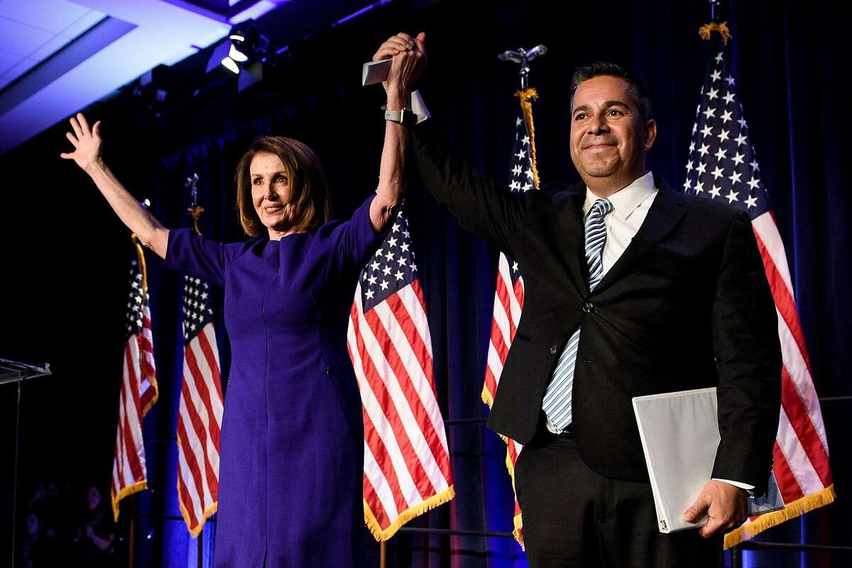 House Minority Leader Nancy Pelosi (D-San Francisco) and Rep. Ben Ray Lujan (D-NM), the DCCC Chairman, celebrate a projected Democratic Party takeover of the House of Representatives on Nov. 7 in Washington, D.C.