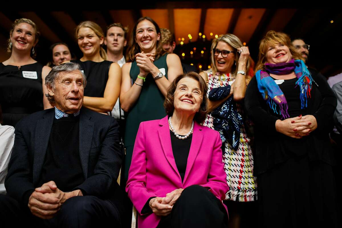 Senator Dianne Feinstein and husband Richard Blum with a crowd of supporters after being re-elected at the Presidio Officers Club in San Francisco, California, on Tuesday, Nov. 6, 2018.