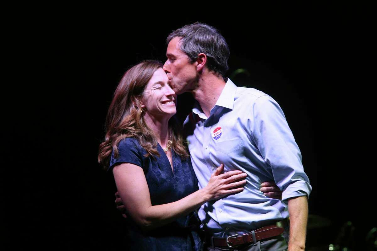 Beto O'Rourke kisses his wife, Amy Sanders, after conceded the race during a rally at Southwest University Park in El Paso, Texas, Tuesday, November 6, 2018. O'Rourke lost to imcumbent U.S. Sen. Ted Cruz.