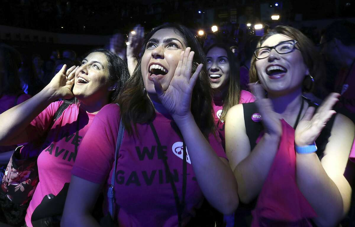 Shanna Niroumandzadeh, center, celebrates as Lt. Gov Gavin Newsom, a Democrat, is declared the next California governor after defeating Republican John Cox, Tuesday, Nov. 6, 2018, in Los Angeles. (AP Photo/Rich Pedroncelli)