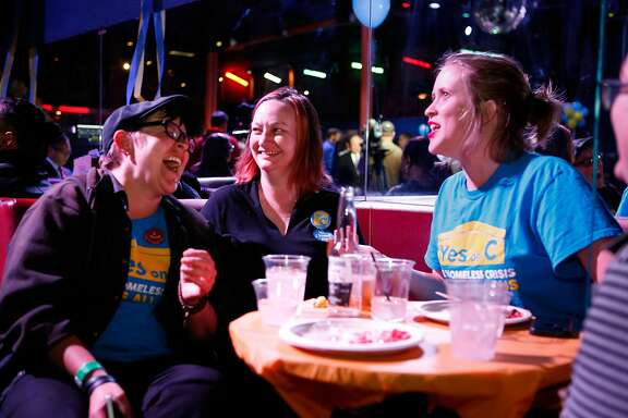 (L to R) Kelley Cutler, Christin Evans, owner of Booksmith and advocate for Prop C, and Katie Martin Selcraig are all smiles after the results at the Yes on C campaign watch party in the Mission District on Tuesday, November 6, 2018 in San Francisco, Calif.