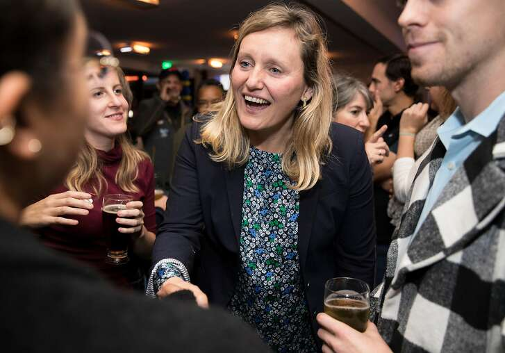 California Assembly District 15 candidate Buffy Wicks greets supporters during a campaign election night party at the Golden Squirrel in Oakland, Calif. Tuesday, Nov. 6, 2018.