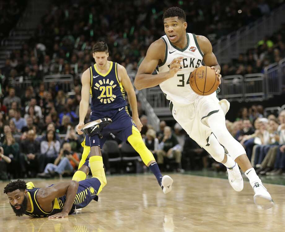 Indiana Pacers guard Tyreke Evans goes down on the court trying to defend Milwaukee Bucks forward Giannis Antetokounmpo during the second half of an NBA basketball game Friday, Oct. 19, 2018, in Milwaukee. Milwaukee won 118-101. (AP Photo/Mike Roemer) Photo: Mike Roemer / Associated Press