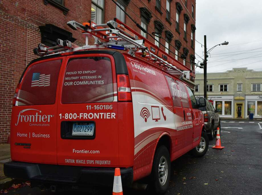 A Frontier Communications crew on a call this month in Norwalk, where the broadband company is based. Photo: Alexander Soule / Hearst Connecticut Media / Stamford Advocate