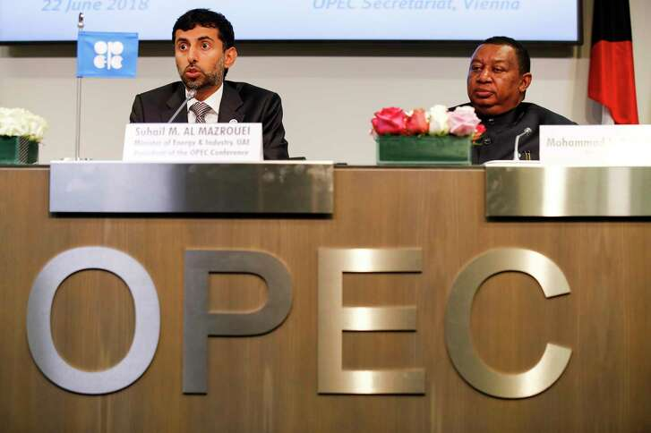 Suhail Mohammed Al Mazrouei (left), United Arab Emirates' energy minister and president of the Organization of Petroleum Exporting Countries, speaks as Mohammed Barkindo, OPEC secretary general, listens during a news conference in Vienna, Austria, on June 22, 2018.