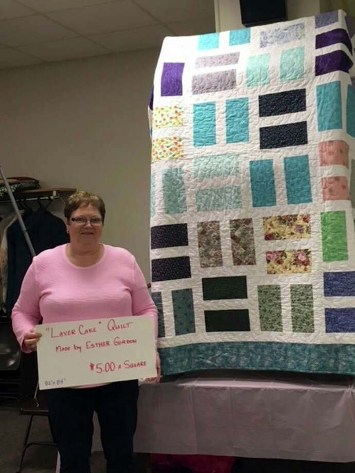 Gretchen Clarke won the Hundred Square game and took home the beautiful 'Layer Cake' quilt made by Coleman Lions member Esther Gordon. (Photo provided)
