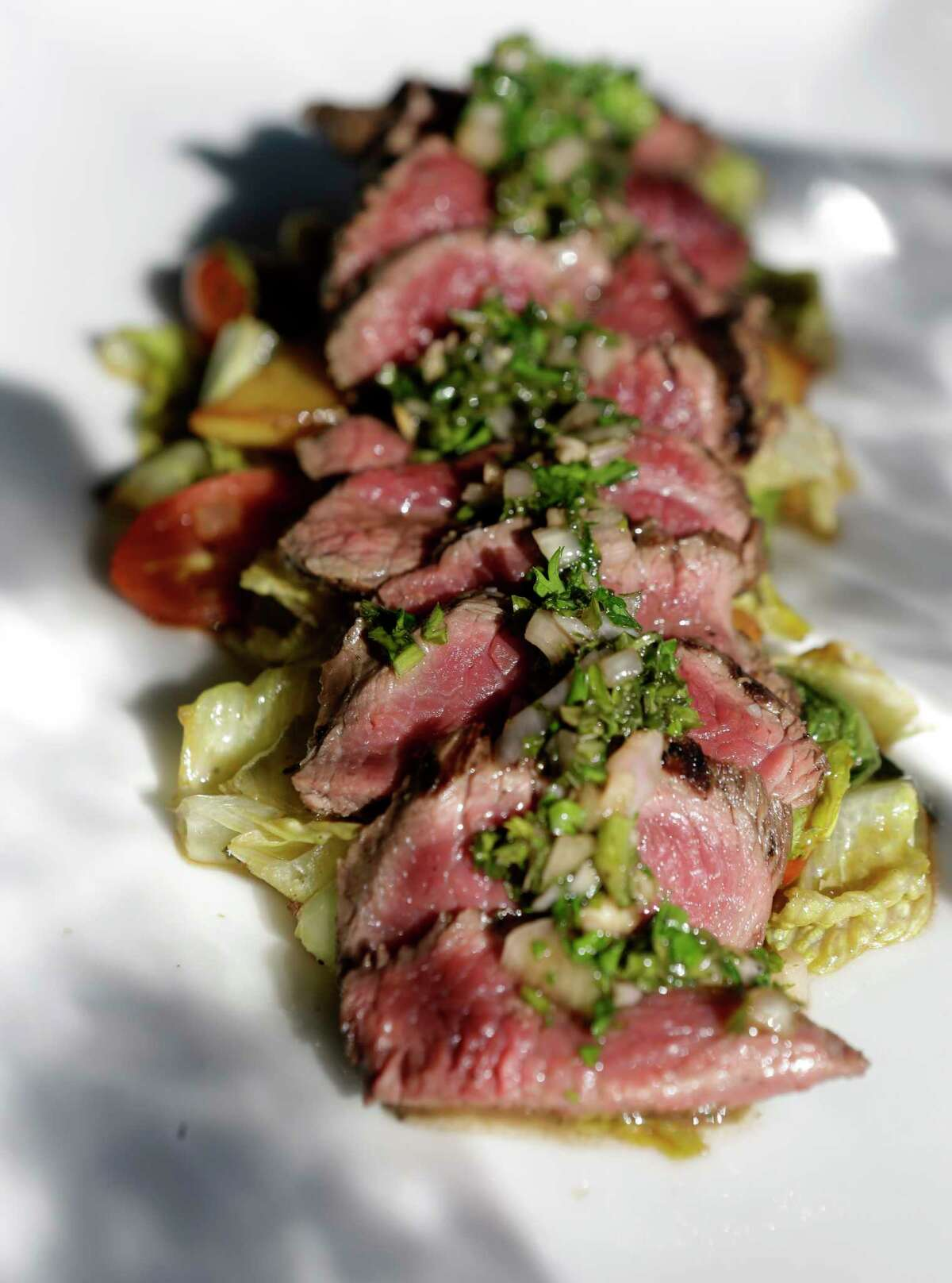 Hanger steak with Yukon Gold potatoes and chimichurri sauce at Avondale Food & Wine in Montrose.