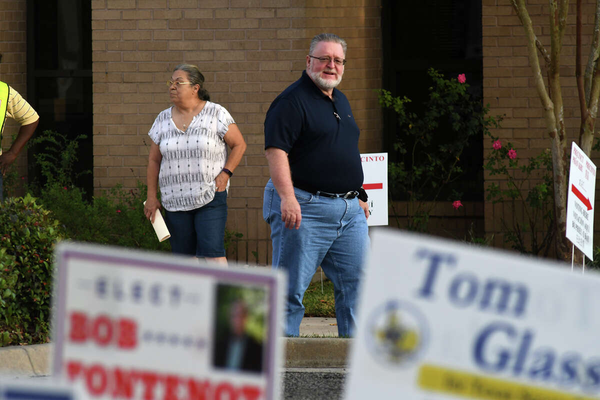 A voter leaves the polling location at Tomball City Hall in the waning hours of Election Day on Nov. 6, 2018.
