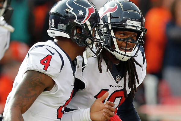 Houston Texans quarterback Deshaun Watson (4) and wide receiver DeAndre Hopkins (10) celebrate Hopkins' 16-yard touchdown reception against the Denver Broncos during the second quarter of an NFL football game at Broncos Stadium at Mile High on Sunday, Nov. 4, 2018, in Denver.