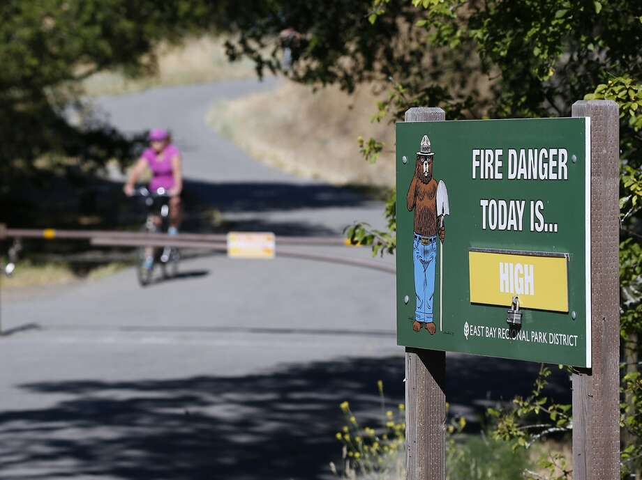 A fire warning is posted at Inspiration Point and the Nimitz Way trailhead in Tilden Regional Park near Orinda, Calif. on Saturday, June 23, 2018. A red flag warning was issued for extreme fire conditions for this week. Photo: Paul Chinn / The Chronicle