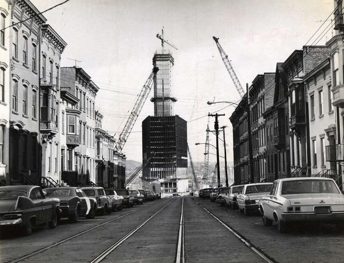Corning tower is framed by row houses in Albany's Center Square neighborhood during construction of the South Mall, 1968, in Albany. (Times Union archive)