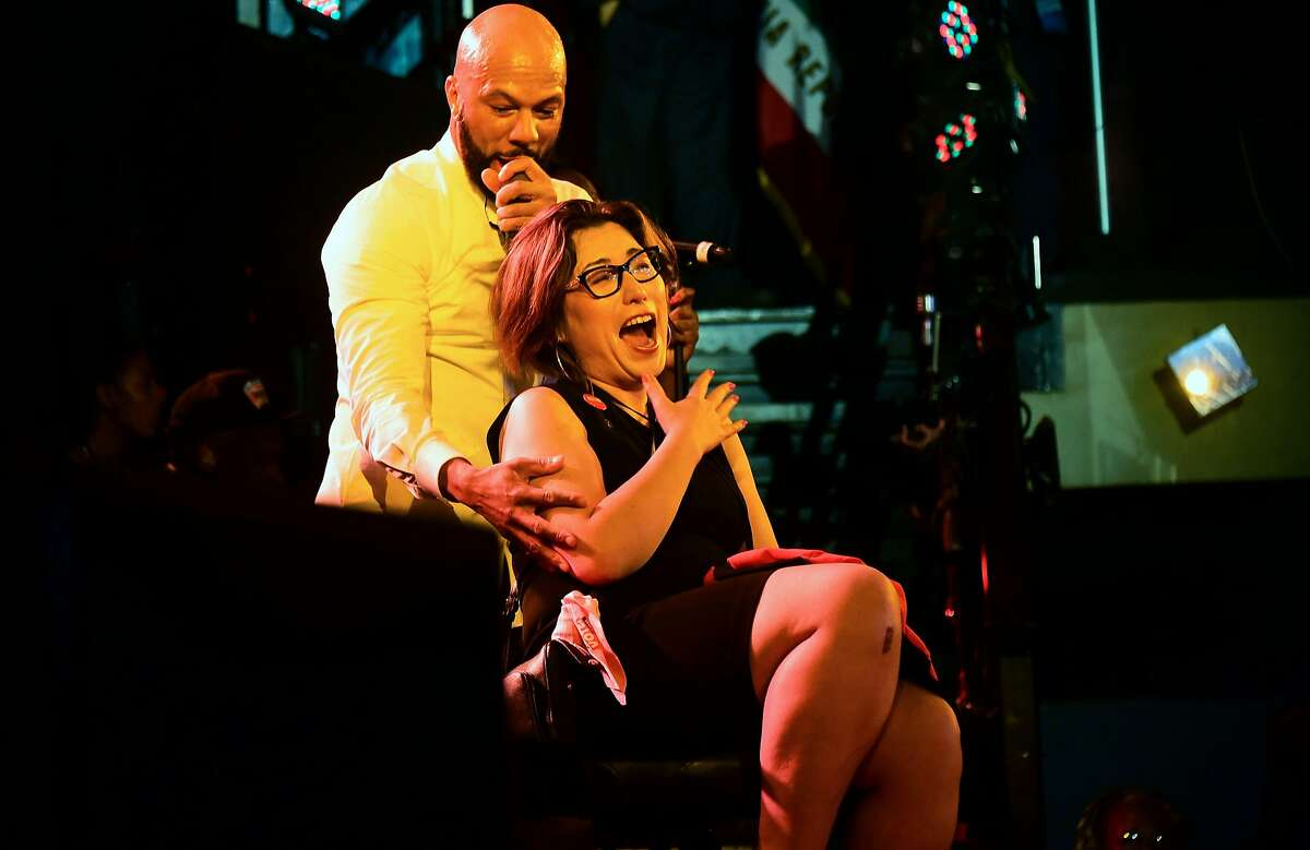 Musician Common performs beside politician Crystal Strait of Sacramento who he invited on stage from the crowd at Gavin Newsom's election night watch party in Los Angeles, California on November 6, 2018. - Gavin Newsom defeated his Republican opponent John Cox to become the next Governor of California. (Photo by Frederic J. BROWN / AFP)FREDERIC J. BROWN/AFP/Getty Images