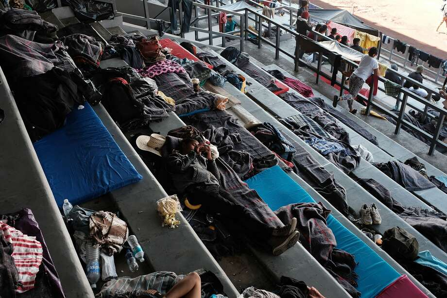 Members of the Central American migrant caravan rest in a stadium after arriving into the Mexican capital yesterday on November 6, 2018 in Mexico City, Mexico. The group, which is estimated to be near 5000 in number, spent the day relaxing, eating and washing after weeks on the road in often grueling conditions. The group of migrants, many of them fleeing violence in their home countries, will conduct meetings over the coming days to decide when and how to continue their  journey towards the United States border. Hundreds more are still heading north in two other migrant caravans. Photo: Spencer Platt/Getty Images