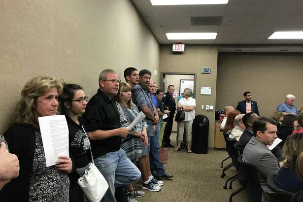 Residents line the walls at a Pearland City Council meeting last year as the city considered annexing some areas in its extraterritorial jurisdiction. The city eventually rescinded annexation of the areas and residents voted Nov. 7 to approve creation of taxing districts to fund emergency services to their areas.