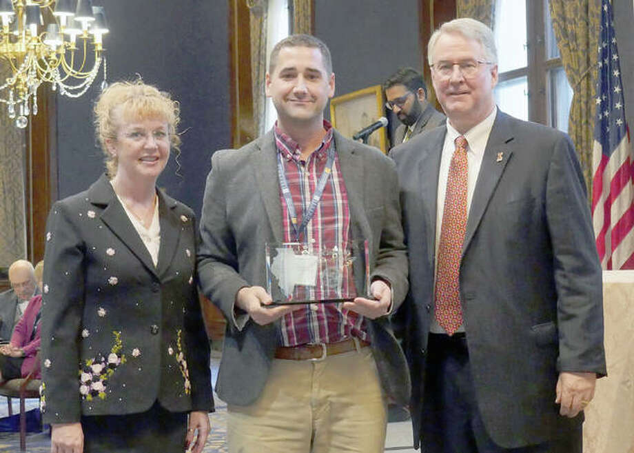 L&C Director of Sustainability Nate Keener, center, poses for a photo with Debra Jacobson, Associate Director of the Illinois Sustainable Technology Center (ISTC) Technical Assistance Program, and Richard Winkel, Jr., Deputy Executive Director of the Prairie Research Institute at the University of Illinois. Photo: For The Telegraph