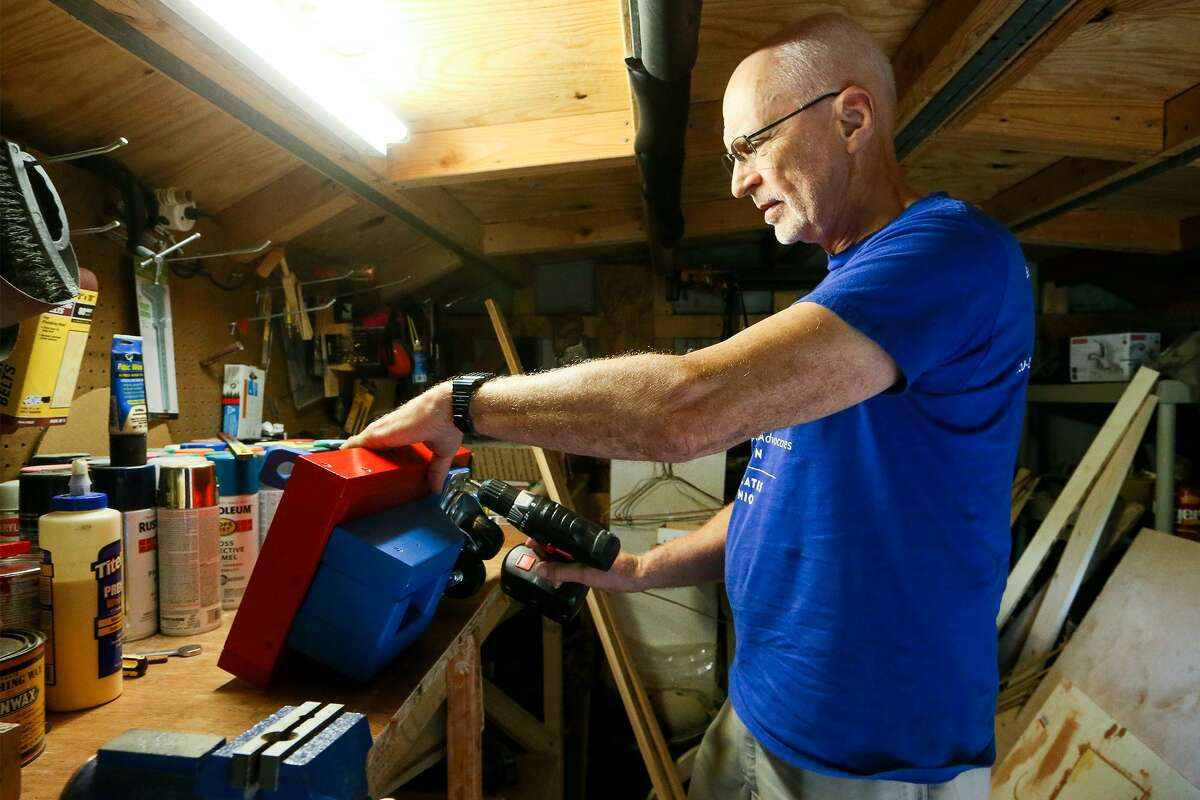 John Faultersack puts wheels on a wooden wagon in his workshop on Nov. 5, 2018. Faultersack creates wooden toys for children who have been removed from their families because of suspected abuse or neglect. He volunteers with the organization Child Advocates San Antonio.