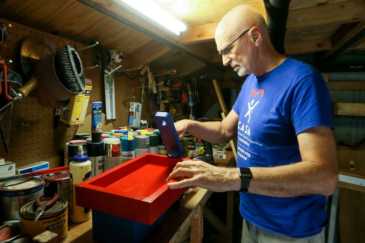 John Faultersack works on a wooden wagon in his workshop on Nov. 5, 2018. Faultersack makes about 35 wooden toys a year to give to children at Christmas. He volunteers with the organization Child Advocates San Antonio, which gives the toys to children in the foster care system.
