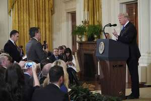 US President Donald Trump points to journalist Jim Acosta from CNN during a post-election press conference in the East Room of the White House in Washington, DC on November 7, 2018. (Photo by Mandel NGAN / AFP)MANDEL NGAN/AFP/Getty Images