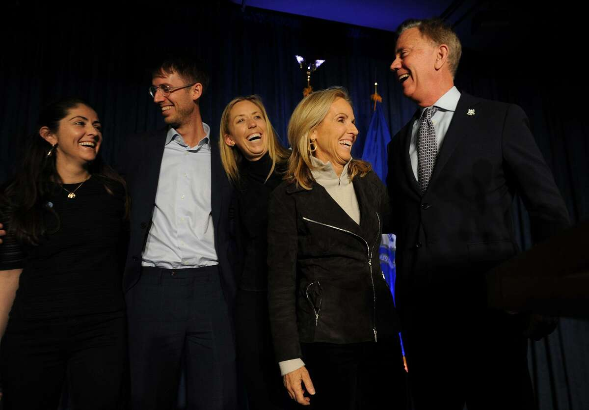 Governor-elect Ned Lamont, right, celebrates with his family after his victory at Dunkin Donuts Park in Hartford, Conn. on Wednesday, November 7, 2018. From left are daughter Emily, 31, son Teddy, 25, daughter Lindsay, 27, and wife Annie.