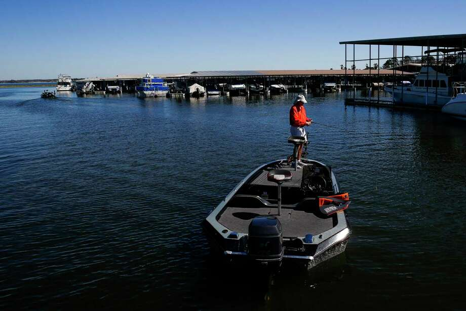 A man fishes for bass from his boat near the Walden Yacht Club on Lake Conroe Wednesday, Feb. 22, 2017 in Montgomery. ( Michael Ciaglo / Houston Chronicle ) Photo: Michael Ciaglo, Staff Photographer / Houston Chronicle / Michael Ciaglo