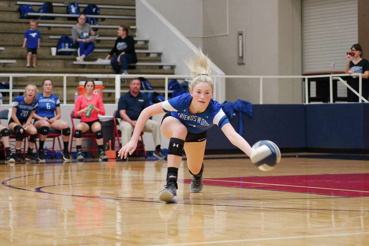 Friendswood's Makensy Manbeck (7) solidifies the middle of the Lady Mustang volleyball defense.