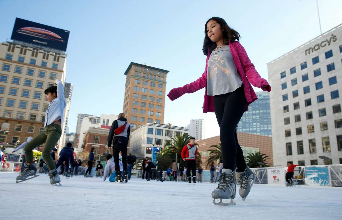 Genesis Mendez, 10, glides around the ice on the opening day of the annual holiday skating rink at Union Square in San Francisco, Calif. on Wednesday, Nov. 7, 2018.