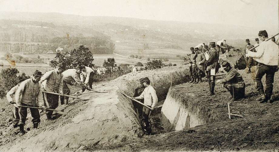 "This file photograph taken on September 10, 1914, shows a picture of a post cardreleased by the Historial de Peronne, Museum of WW1, French soldiers, nicknamed ""Poilus"", digging a trench during the First Battle of the Marne during the World War I. - The First World War was first a gigantic European melee, the outcome of which was played on the Western Front, in France and Belgium, where the most deadly battles took place. (Photo by - / Historial de Péronne / AFP)-/AFP/Getty Images"