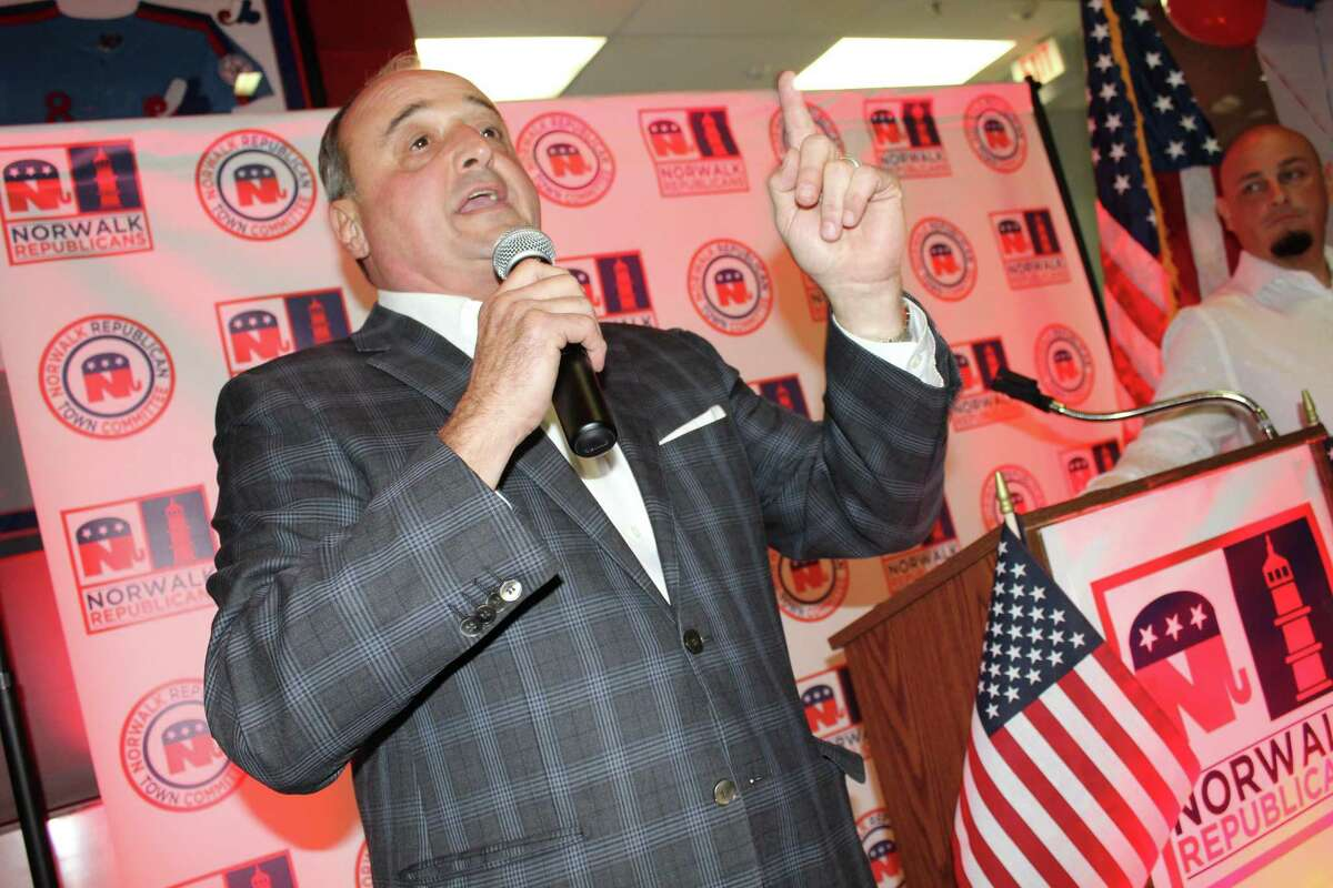 Lawrence Cafero, the Republican candidate for judge of the Norwalk-Wilton Probate Court, gives a speech at the SoNo Ice House after conceding to his opponent, Democrat Doug Stern