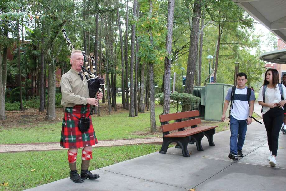 Craig Livingston, a history professor at Lone Star College-Montgomery, performs bagpipe ballads on campus to commemorate the 100th anniversary of the end of World War I. Photo: Jane Stueckemann/The Villager / Jane Stueckemann/The Villager