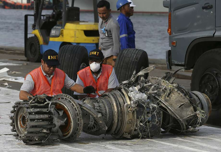 Officials inspect an engine recovered from the crashed Lion Air jet on Monday in Jakarta, Indonesia, Sunday, Nov. 4, 2018. The brand new Boeing 737 MAX 8 jet plunged into the Java Sea just minutes after takeoff from Jakarta early on Oct. 29, killing all of its passengers on board. (AP Photo/Achmad Ibrahim) Photo: Achmad Ibrahim, Associated Press