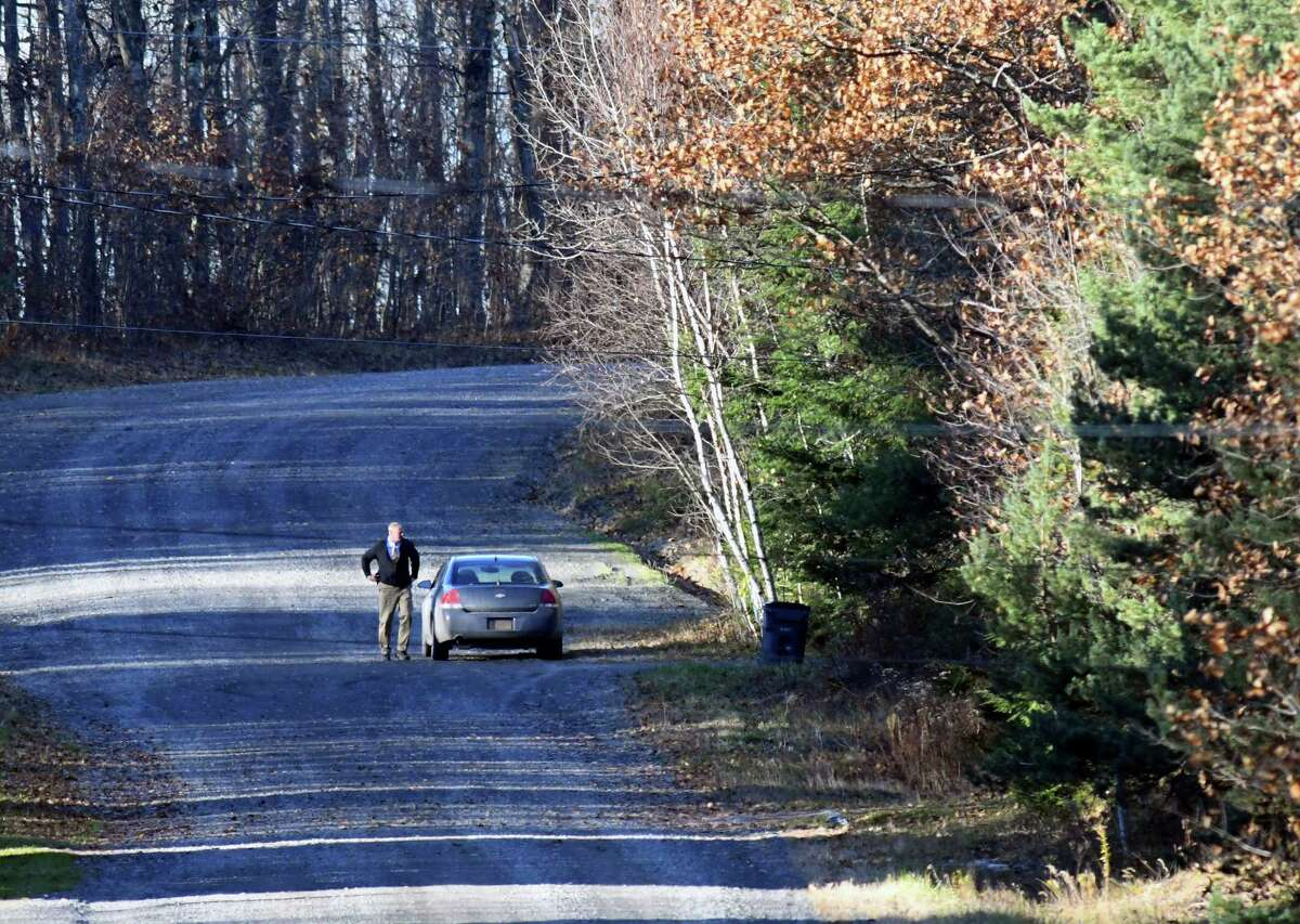 A New York State Police investigator arrives at the scene of a Rossman Valley Road home where two suspicious deaths are being investigated on Wednesday, Nov. 7, 2018, in Summit, N.Y. A preliminary investigation has revealed the individuals died overnight Monday. (Will Waldron/Times Union)