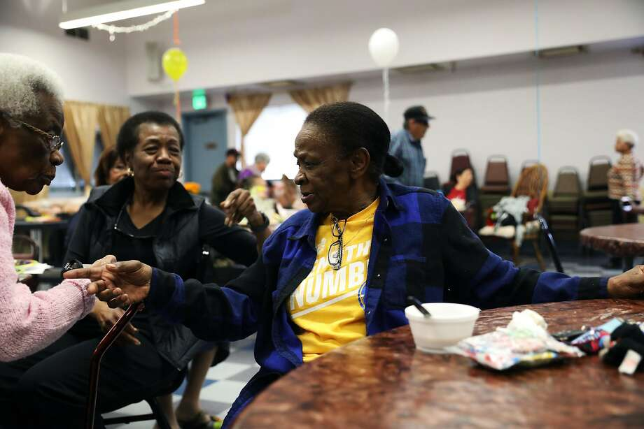 Clara Pennant, left, and Joann Adger converse with Shirley Williams as they eat breakfast at the East Palo Alto Senior Center in East Palo Alto, Calif., on Wednesday, October 31, 2018. Photo: Yalonda M. James / The Chronicle