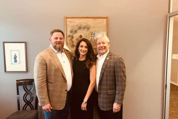 Mark Woodroof, managing partner of Gary Greene (right) with Blake and Emily Wilcox of Blake Wilcox Properties.