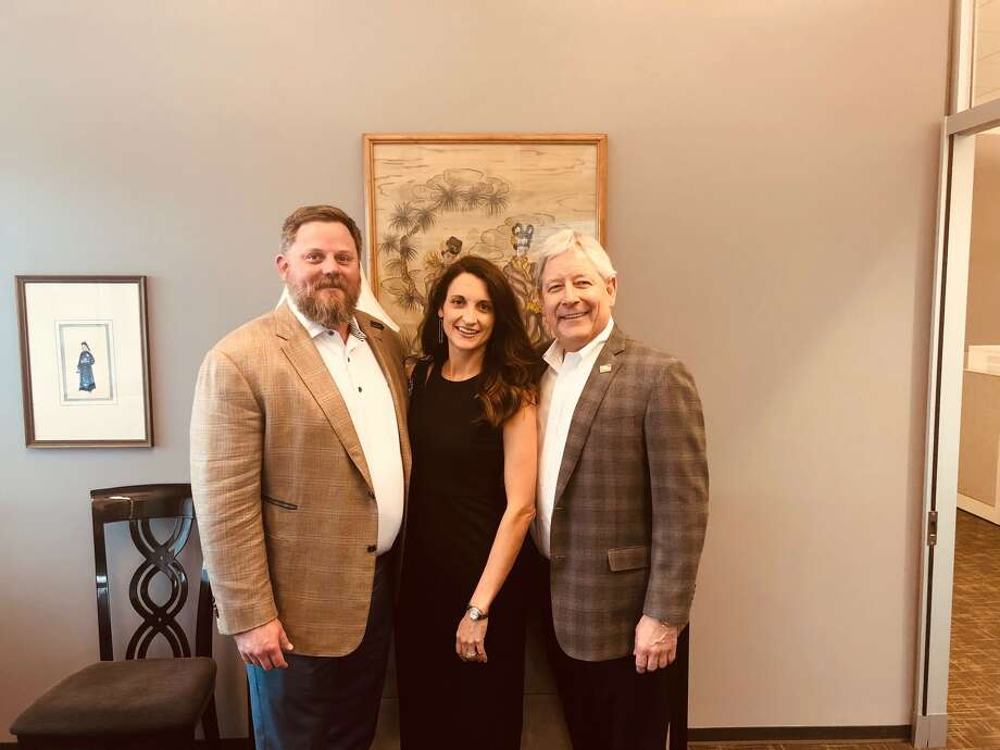 Mark Woodroof, managing partner of Gary Greene (right) with Blake and Emily Wilcox of Blake Wilcox Properties. Photo: Better Homes And Gardens Real Estate Gary Greene