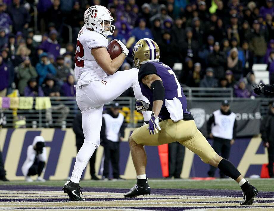 SEATTLE, WA - NOVEMBER 03: Kaden Smith #82 of the Stanford Cardinal scores a 14 yard touchdown against Taylor Rapp #7 of the Washington Huskies in the third quarter during their game at Husky Stadium on November 3, 2018 in Seattle, Washington.  (Photo by Abbie Parr/Getty Images) Photo: Abbie Parr / Getty Images 2018