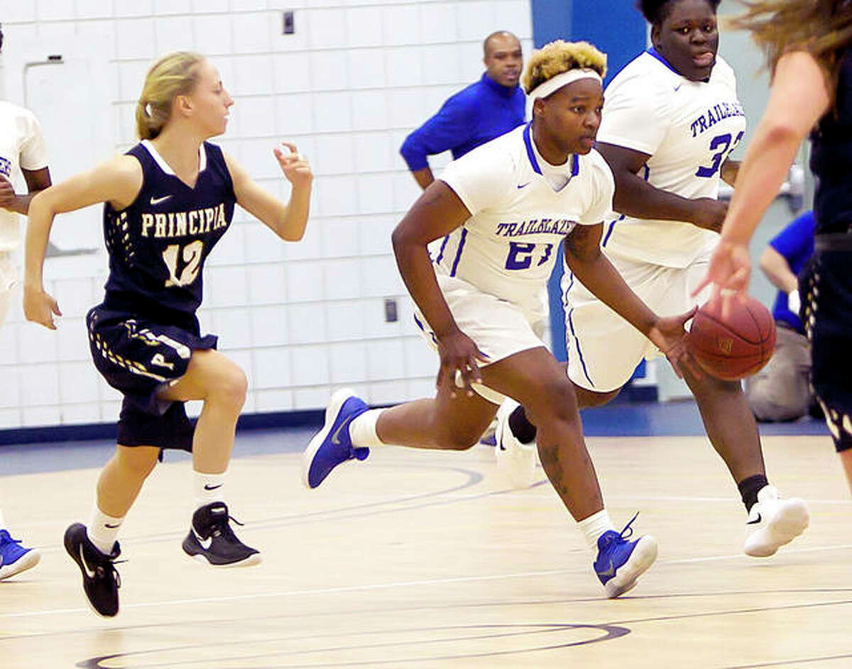 Juantia Walton of Lewis and Clark (21) is one of three returning starters this season for the Trailblazers. She is shown in action against Principia last season.