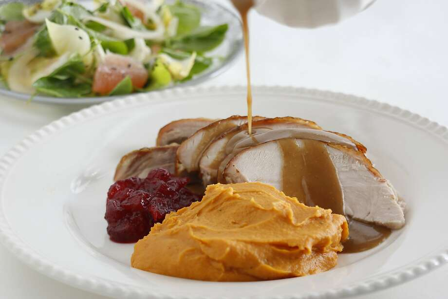 A classic sight: Roast turkey slices with gravy and sweet Potato puree with brown sugar and cream. Photo: Craig Lee