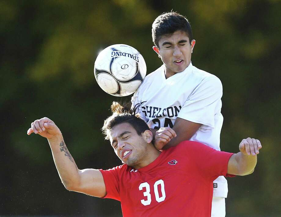 Greenwich's Farid Ghaliya (30) and Shelton's Deven Papadimitriou (24) battle for a header in No. 16 Greenwich's 2-0 win over No. 17 Shelton in the first round match of the CIAC Class LL high school boys soccer tournament at Greenwich High School in Greenwich, Conn. Wednesday, Nov. 7, 2018. Photo: Tyler Sizemore / Hearst Connecticut Media / Greenwich Time
