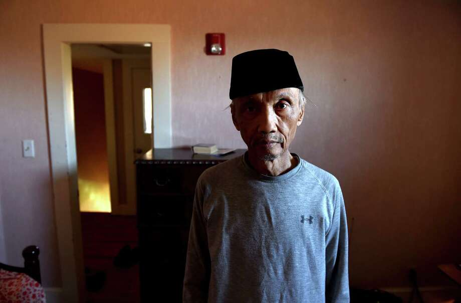 Sujitno Sajuti is photographed in his makeshift bedroom at the Unitarian Universalist Church in Meriden on November 7, 2018. Photo: Arnold Gold, Hearst Connecticut Media / New Haven Register