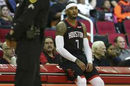 Although Carmelo Anthony isn't a starter with the Rockets, it isn't long into a game before he's at the scorer's table, waiting to check in.