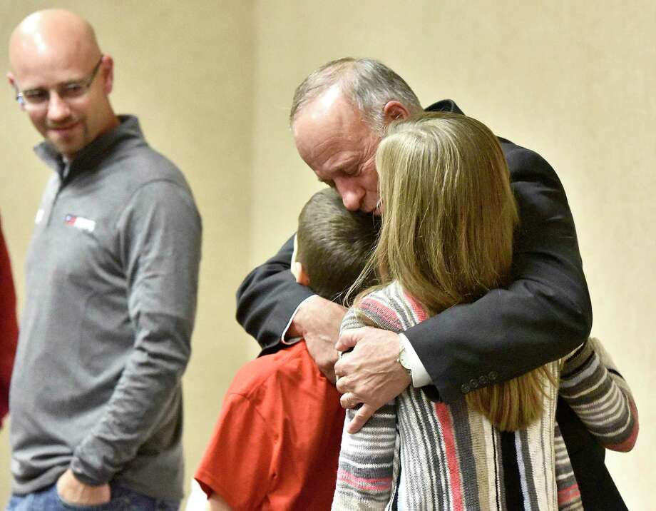 Steve King, Republican incumbent in Iowa's 4th Congressional District, hugs grandchildren Gabe King and Rachel King as Steve King's son and campaign worker, Jeff King, looks on during an election watch party held in a Sioux City, Iowa, conference center Tuesday, Nov. 6, 2018. King beat Democratic challenger J.D. Scholten. (Tim Hynds/Sioux City Journal via AP) Photo: Tim Hynds, AP / Copyright Sioux City Journal