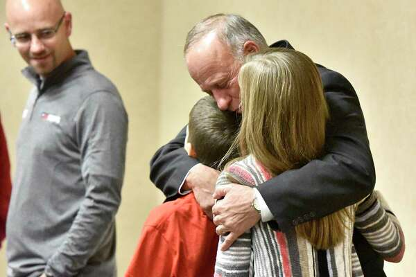 Steve King, Republican incumbent in Iowa's 4th Congressional District, hugs grandchildren Gabe King and Rachel King as Steve King's son and campaign worker, Jeff King, looks on during an election watch party held in a Sioux City, Iowa, conference center Tuesday, Nov. 6, 2018. King beat Democratic challenger J.D. Scholten. (Tim Hynds/Sioux City Journal via AP)