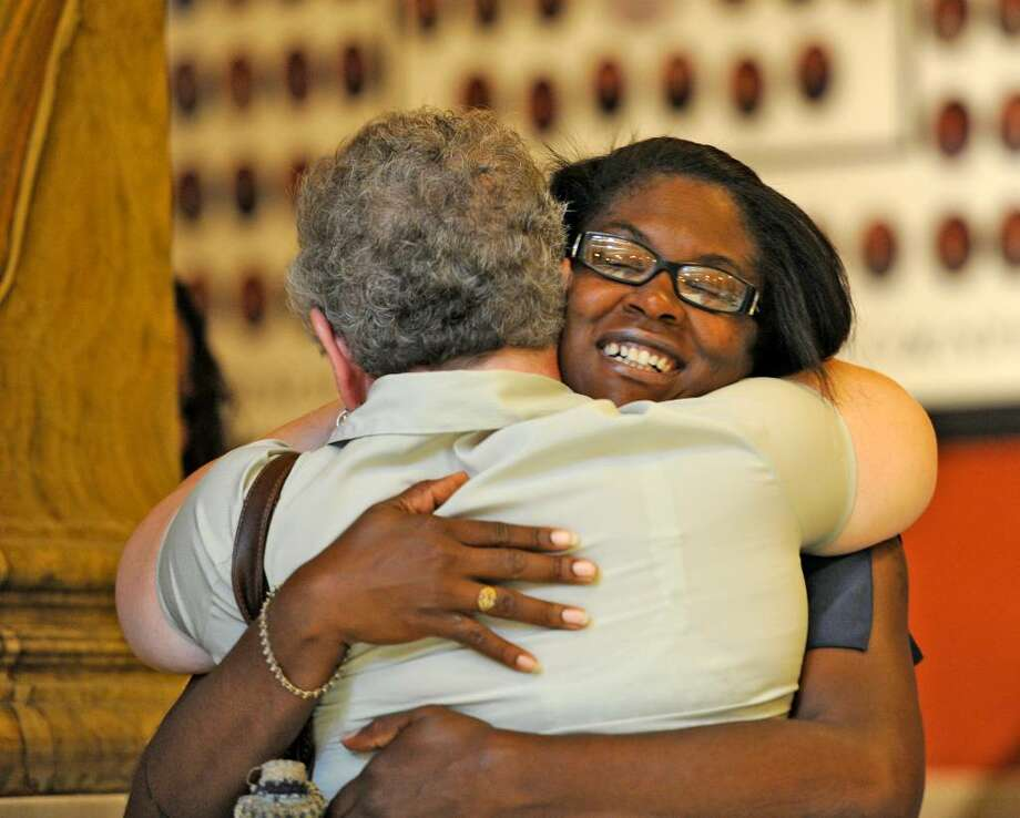 Tara Pompey, Terrence Battiste's wife, gets a hug from Kathy Snay, Bryan Berry's  mother, before court Friday to hear that murder charges would be dropped against the two men.  (Skip Dickstein / Times Union) Photo: Skip Dickstein / 2008
