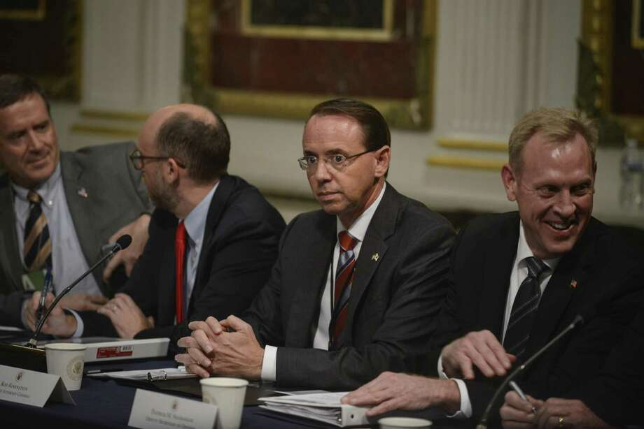 FILE-- Deputy Attorney General Rod Rosenstein attends a task force meeting at the White House in Washington, Oct. 11, 2018. Under normal circumstances, the firing of Jeff Sessions would make Rosenstein the acting attorney general, but the Vacancies Reform Act gives a president the authority to temporarily install someone else without Senate confirmation. (Gabriella Demczuk/The New York Times) Photo: GABRIELLA DEMCZUK, STR / NYT / NYTNS