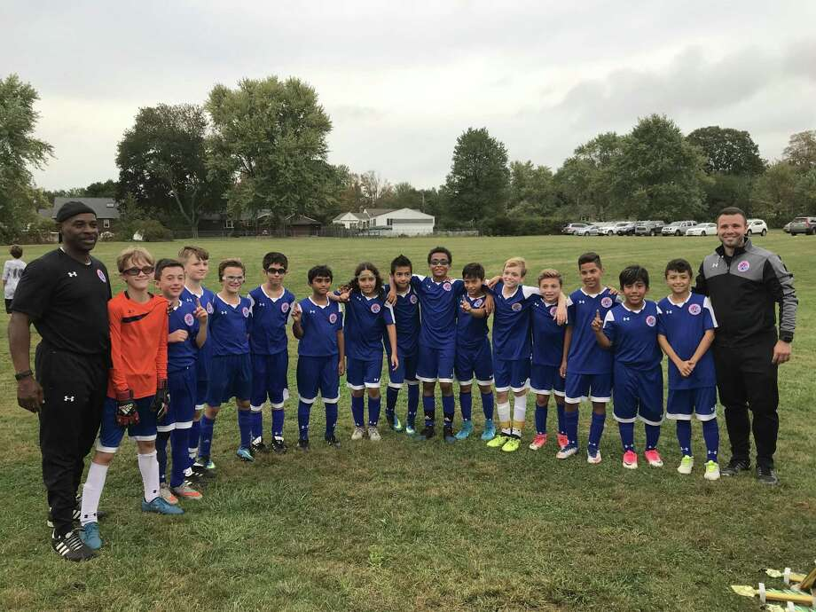 The Norwalk Junior Soccer U12 boys soccer team navigated their way through a 64-team single-elimination tournament to reach the state championship for their age group. Photo: Contributed Photo / Greenwich Time Contributed