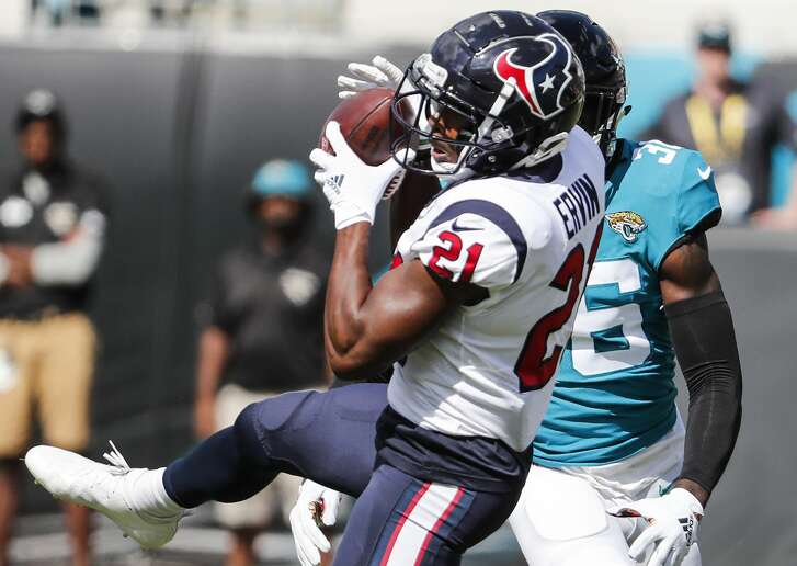 Houston Texans running back Tyler Ervin (21) pulls down a first down reception past Jacksonville Jaguars defensive back Ronnie Harrison (36) for a first down during the third quarter of an NFL football game at TIAA Bank Field on Sunday, Oct. 21, 2018, in Jacksonville.