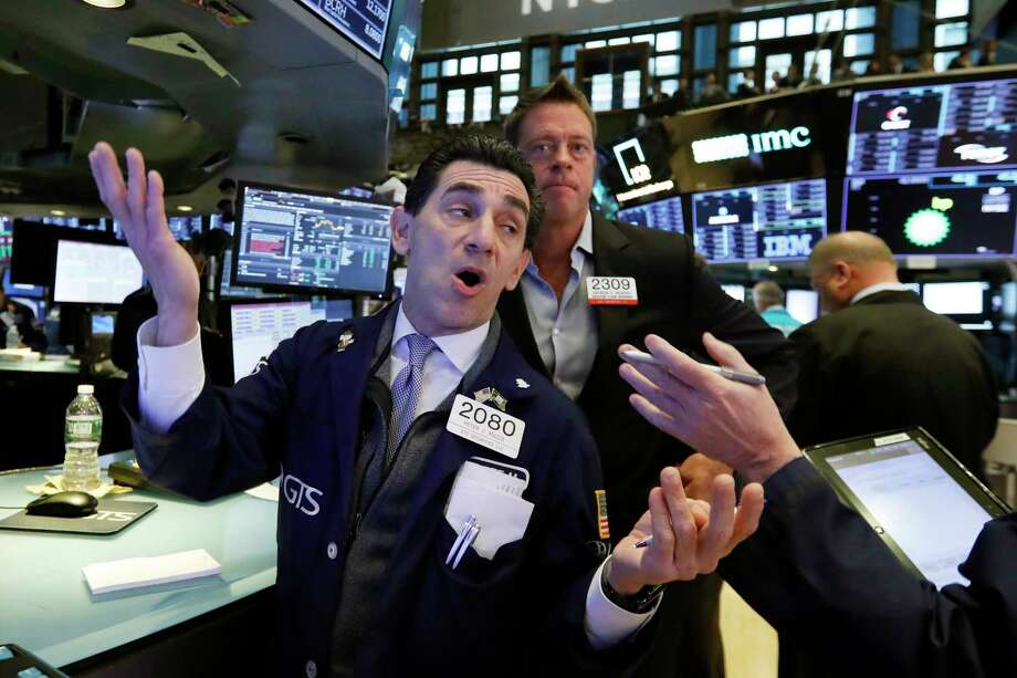 Specialist Peter Mazza, left, works on the floor of the New York Stock Exchange, Wednesday, Nov. 7, 2018. Stocks are climbing in early trading on Wall Street as results of the U.S. midterm elections came in as investors had expected. (AP Photo/Richard Drew) Photo: Richard Drew / Copyright 2018 The Associated Press. All rights reserved