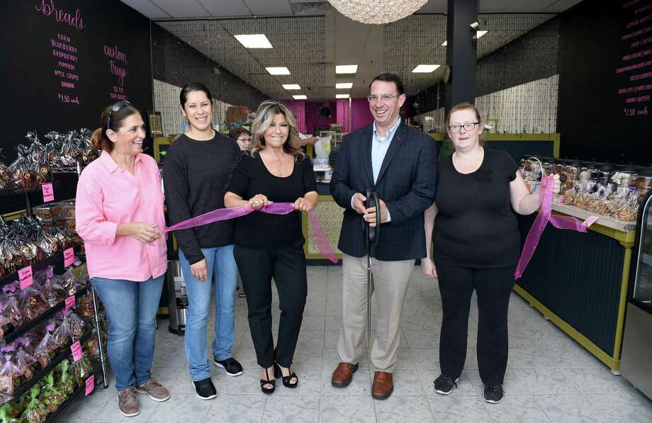 From left, customer Bela DeBrum of Milford, manager Lisbeth Fortin, owner Kathy Klein, Milford Mayor Ben Blake and cupcake manager Sally Hehn, also below, take part in a ribbon cutting for Kathy's Famous Cookies at their new location at 1365 New Haven Avenue in Milford on November 7, 2018. Photo: Arnold Gold / Hearst Connecticut Media / New Haven Register