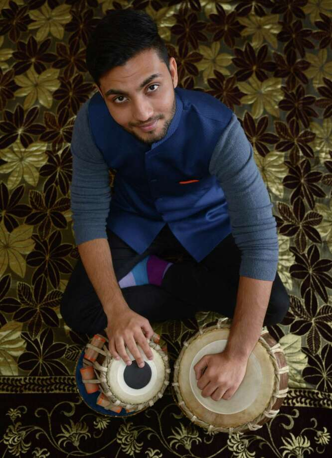 Local resident and musician Milan Ganatra practices the traditional Indian instrument, the tabla, in his home Saturday, November 3, 2018, in Norwalk, Conn. Gannatra immigrated to USA recently and now performs and teaches the traditional percussion instrument. Photo: Erik Trautmann / Hearst Connecticut Media / Norwalk Hour
