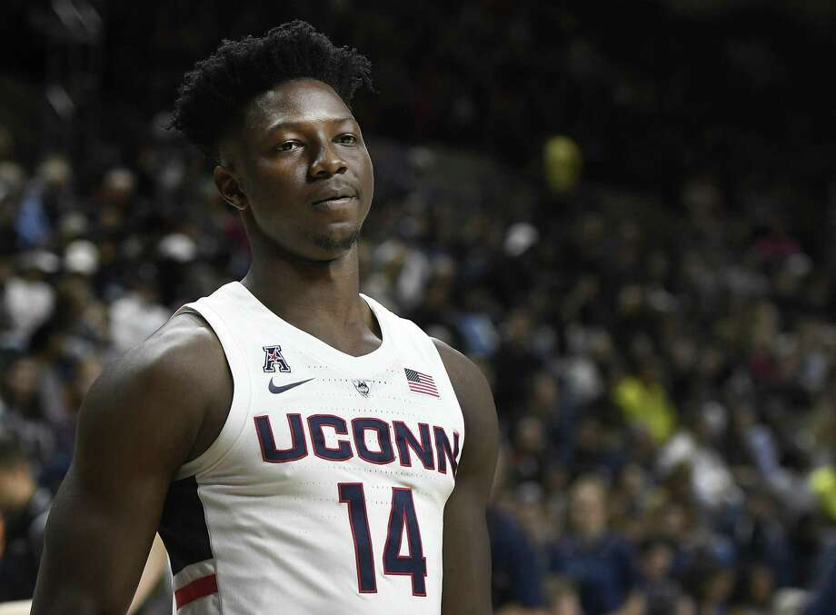 FILE - In this Friday, Oct. 12, 2018, file photo, Connecticut's Kassoum Yakwe watches during the UConn's men's and women's basketball teams annual First Night celebration in Storrs, Conn. Yakwe, a 6-foot-7 graduate transfer from St. John's, is expected to add needed strength, shot blocking and depth to the frontcourt. (AP Photo/Jessica Hill, File) Photo: Jessica Hill / Associated Press / Copyright 2018 The Associated Press. All rights reserved